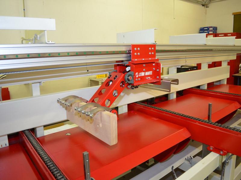 Positionerschieber mit Kopfanpressung über automatischer Materialzuführung